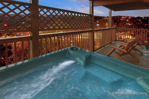 lower level deck with hot tub at smoky mountain lodge a 7 bedroom cabin rental located in gatlinburg