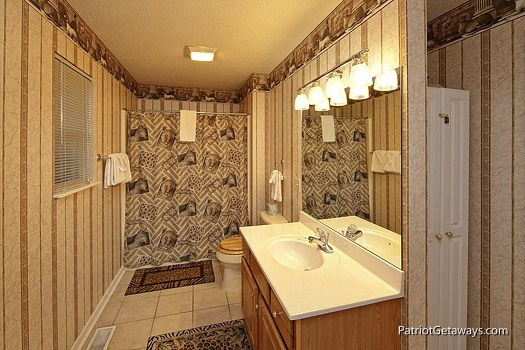 main level bathroom at smoky mountain lodge a 7 bedroom cabin rental located in gatlinburg