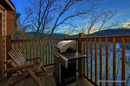 main level deck with grill at smoky mountain lodge a 7 bedroom cabin rental located in gatlinburg