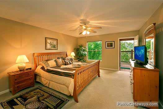 main level king bedroom with attached bath at smoky mountain lodge a 7 bedroom cabin rental located in gatlinburg