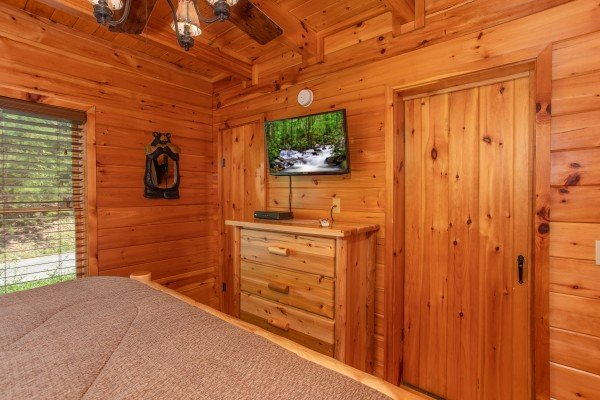 King bedroom with dresser and television at Dancin Bear Hideaway, a 2-bedroom cabin rental located in Pigeon Forge