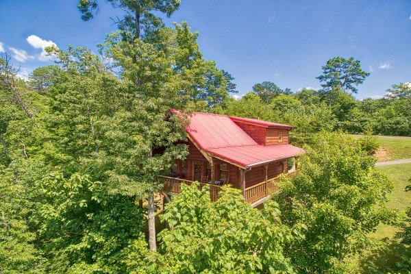 Cabin nestled in the trees called Dancin Bear Hideaway, cabin rental located in Pigeon Forge