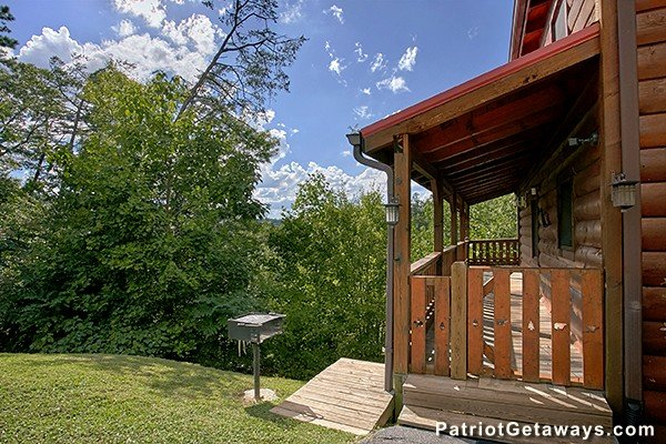 Grill next to the deck with a gate at Dancin Bear Hideaway, a 2-bedroom cabin rental located in Pigeon Forge