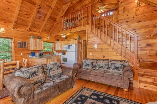 Open concept living room at Dancin Bear Hideaway, a 2-bedroom cabin rental located in Pigeon Forge