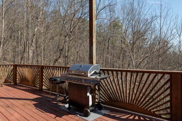 Grill on the deck at Kaleidoscope, a 2 bedroom cabin rental located in Pigeon Forge