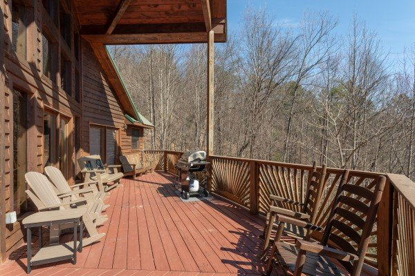 Deck seating at Kaleidoscope, a 2 bedroom cabin rental located in Pigeon Forge