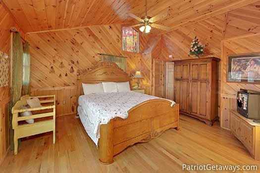 King bed in bedroom at Kaleidoscope, a 2 bedroom cabin rental located in Pigeon Forge