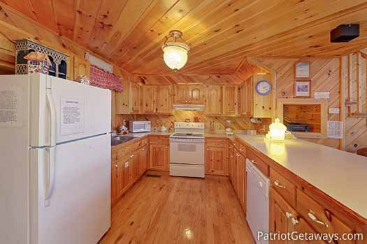 Kitchen with white appliances at Kaleidoscope, a 2 bedroom cabin rental located in Pigeon Forge