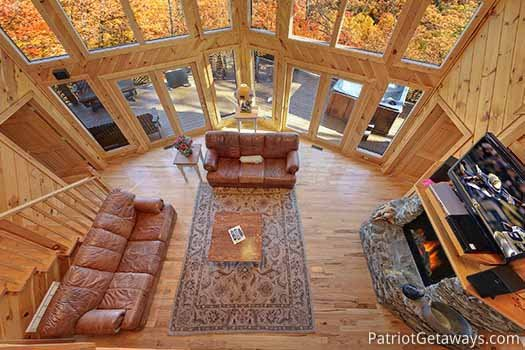 Living room view from loft at Kaleidoscope, a 2 bedroom cabin rental located in Pigeon Forge