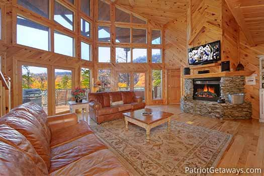 Living room with floor to ceiling windows at Kaleidoscope, a 2 bedroom cabin rental located in Pigeon Forge