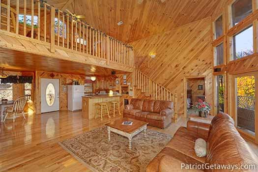 Living room with sofa bed at Kaleidoscope, a 2 bedroom cabin rental located in Pigeon Forge