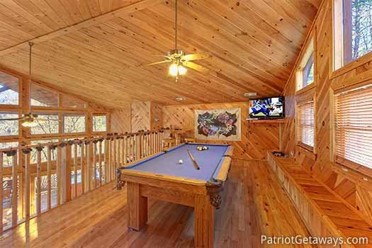 Lofted game room with pool table at Kaleidoscope, a 2 bedroom cabin rental located in Pigeon Forge
