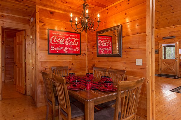 Dining space with seating for six at Moonshine Memories, a 2 bedroom cabin rental located in Gatlinburg