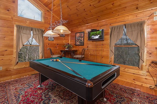 Green felt pool table at Moonshine Memories, a 2 bedroom cabin rental located in Gatlinburg