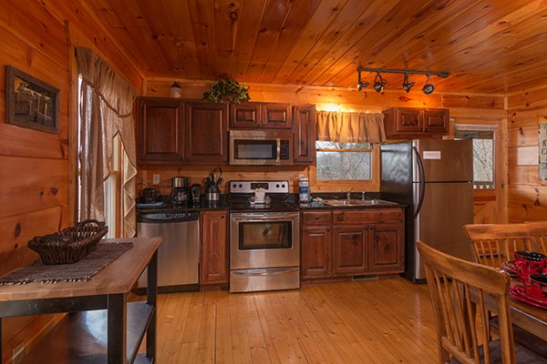 Kitchen with stainless appliances at Moonshine Memories, a 2 bedroom cabin rental located in Gatlinburg