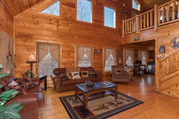 Living room with a sofa and chair at Moonshine Memories, a 2 bedroom cabin rental located in Gatlinburg