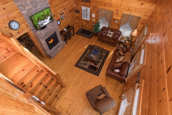 Looking down into the living room at Moonshine Memories, a 2 bedroom cabin rental located in Gatlinburg