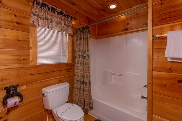 Bathroom with a tub and shower at Moonshine Memories, a 2 bedroom cabin rental located in Gatlinburg