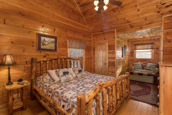 Bedroom with a king bed at Moonshine Memories, a 2 bedroom cabin rental located in Gatlinburg
