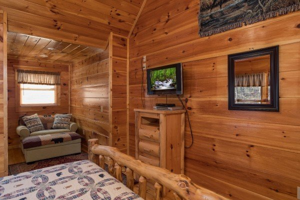 Dresser and TV in a bedroom at Moonshine Memories, a 2 bedroom cabin rental located in Gatlinburg