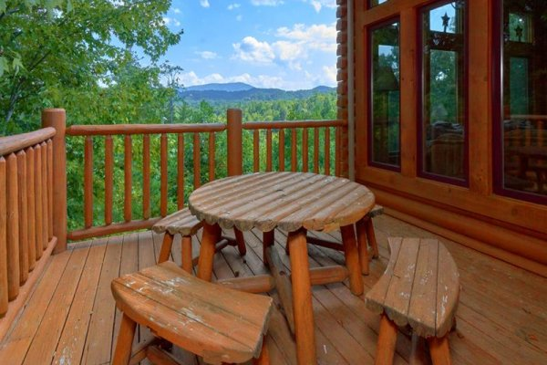 Dining set on the deck at Wagon Wheel Cabin, a 3 bedroom cabin rental located in Pigeon Forge