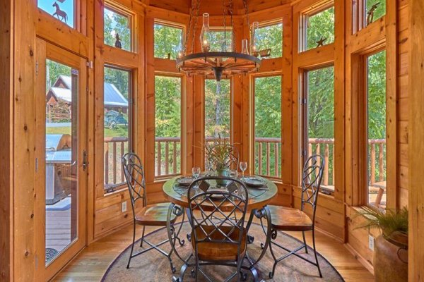 Dining nook for four at Wagon Wheel Cabin, a 3 bedroom cabin rental located in Pigeon Forge