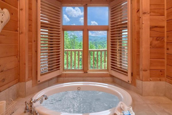 Jacuzzi on the main floor at Wagon Wheel Cabin, a 3 bedroom cabin rental located in Pigeon Forge