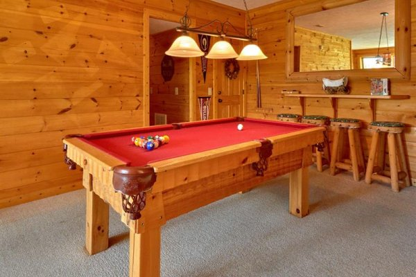 Pool table in the game room at Wagon Wheel Cabin, a 3 bedroom cabin rental located in Pigeon Forge