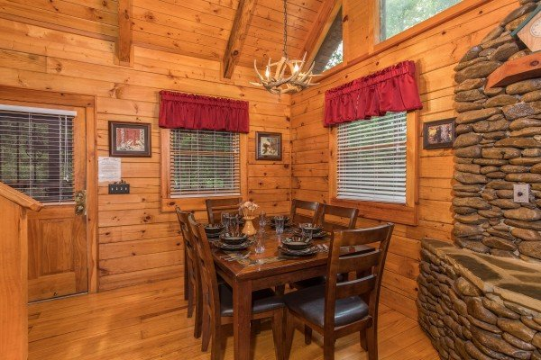 Dining room with seating for six at Bear's Lair, a 2-bedroom cabin rental located in Pigeon Forge