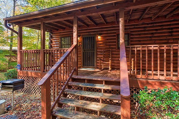 Front porch entry at Bear's Lair, a 2-bedroom cabin rental located in Pigeon Forge