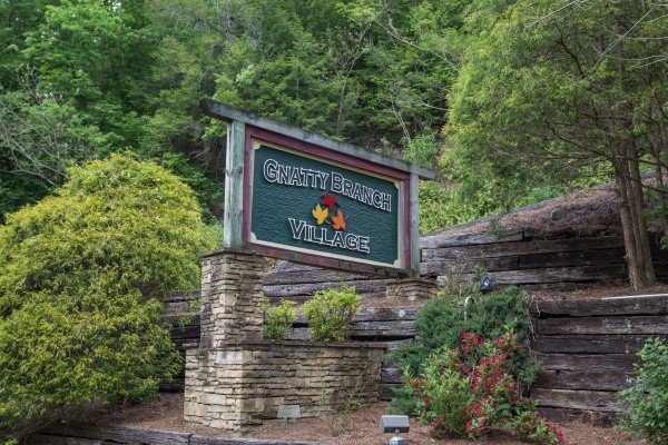 Gnatty Branch Village resort sign at Bear's Lair, a 2-bedroom cabin rental located in Pigeon Forge