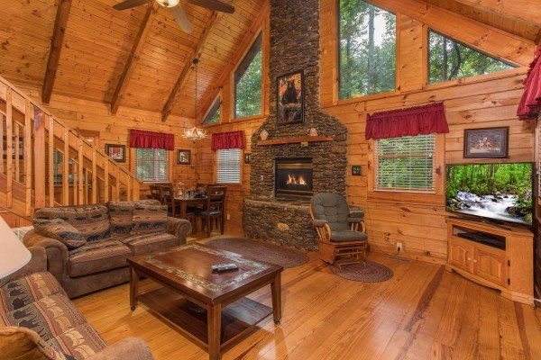 Stacked stone fireplace in the living room at Bear's Lair, a 2-bedroom cabin rental located in Pigeon Forge