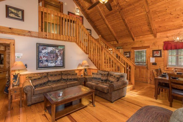 Living room seating at Bear's Lair, a 2-bedroom cabin rental located in Pigeon Forge