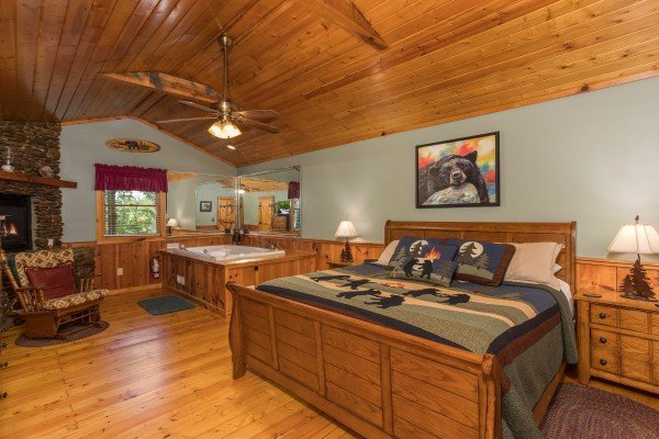 King-sized wood bed at Bear's Lair, a 2-bedroom cabin rental located in Pigeon Forge