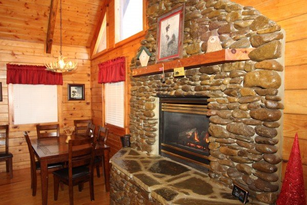 River stone fireplace at Bear's Lair, a 2-bedroom cabin rental located in Pigeon Forge