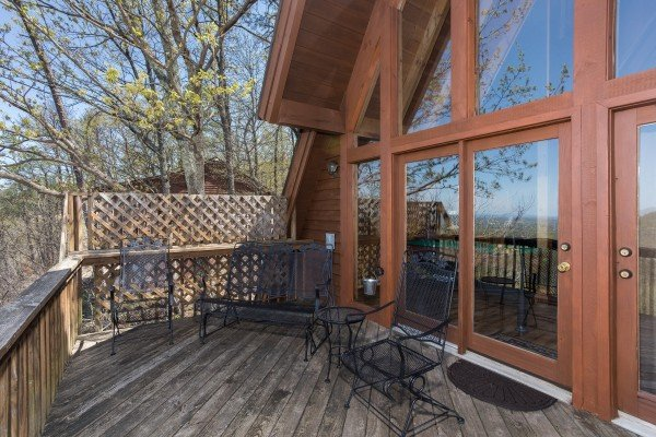 Deck with two chairs and a loveseat at Cozy Mountain View, a 1-bedroom cabin rental located in Pigeon Forge