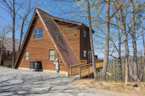 Exterior and flat parking at Cozy Mountain View, a 1-bedroom cabin rental located in Pigeon Forge