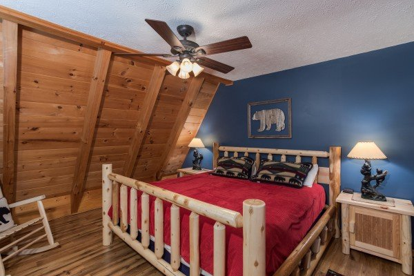 Bedroom with a king-sized log bed at Cozy Mountain View, a 1-bedroom cabin rental located in Pigeon Forge