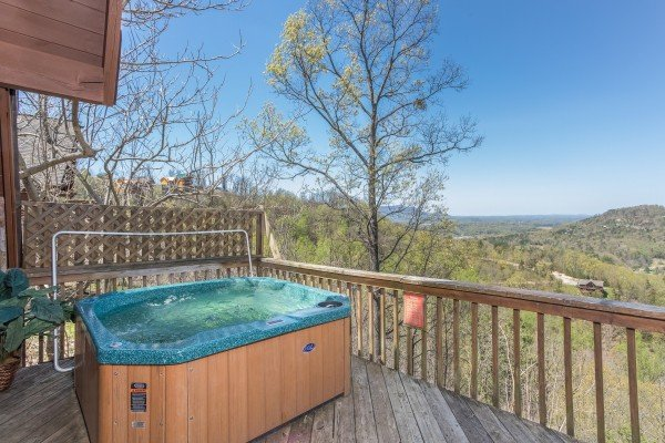Hot tub on a deck with winter views at Cozy Mountain View, a 1-bedroom cabin rental located in Pigeon Forge