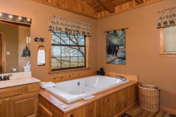 Jacuzzi tub in a bathroom at Cozy Mountain View, a 1-bedroom cabin rental located in Pigeon Forge