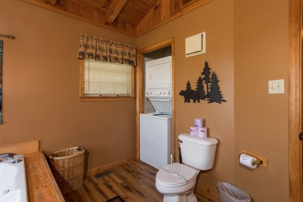Stacked washer and dryer in a bathroom at Cozy Mountain View, a 1-bedroom cabin rental located in Pigeon Forge
