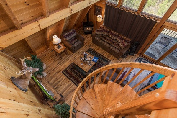Spiral staircase leading down into the living space at Cozy Mountain View, a 1-bedroom cabin rental located in Pigeon Forge