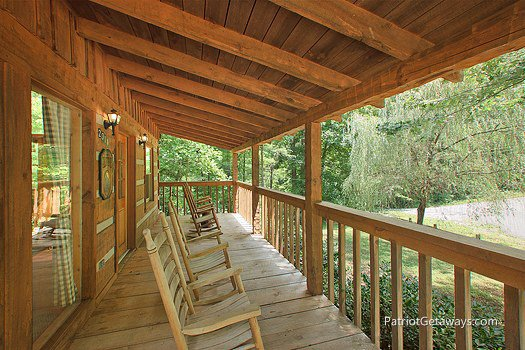 Two rocking chairs on deck at Call of the Wild, a 1-bedroom cabin rental located in Pigeon Forge