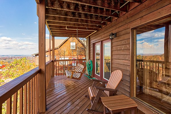 Swing and rocker on the lower deck at The Bear's House, a 4 bedroom cabin rental in Pigeon Forge