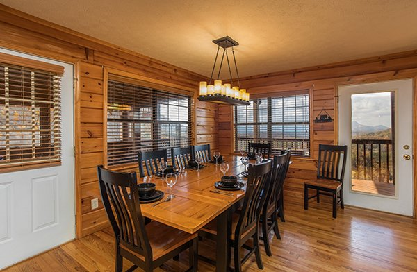 Dining space for eight at The Bear's House, a 4 bedroom cabin rental in Pigeon Forge