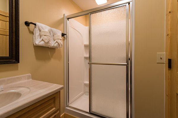 Shower in a bathroom at The Bear's House, a 4 bedroom cabin rental in Pigeon Forge