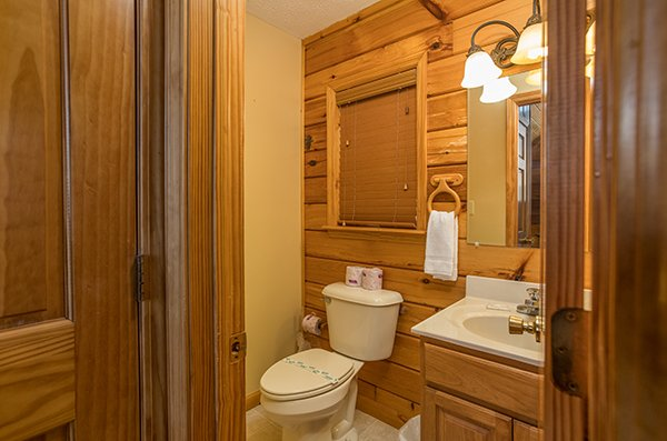 Half bath off the home theater at The Bear's House, a 4 bedroom cabin rental in Pigeon Forge