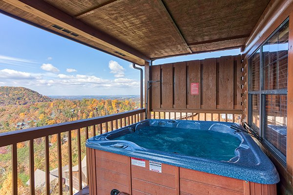 Hot tub on a covered deck with a privacy fence at The Bear's House, a 4 bedroom cabin rental in Pigeon Forge