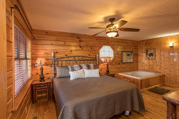 King bedroom with a jacuzzi at The Bear's House, a 4 bedroom cabin rental in Pigeon Forge