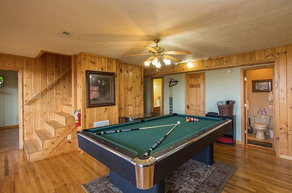 Pool table on the lower level at The Bear's House, a 4 bedroom cabin rental in Pigeon Forge